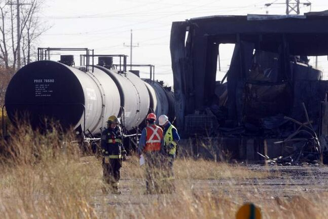 Wpg Fire investigators are on scene checking out 4 tanker rail cars and a tanker truck at the scene of  last evenings fire.  Fire aftermath from a large fire that destroyed Speedway International at Nicholas Ave near Marion St.  KEN GIGLIOTTI  / WINNIPEG FREE PRESS  /  OCT. 2  2012
