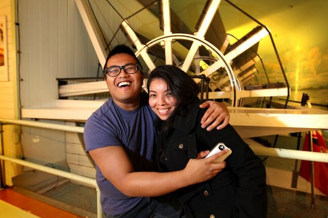 Mark Ricafort and Rina Mejia pose in front of the iconic paddlewheel Wednesday afternoon.
