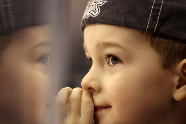 A young Winnipeg Jets fan watches the team warm up.