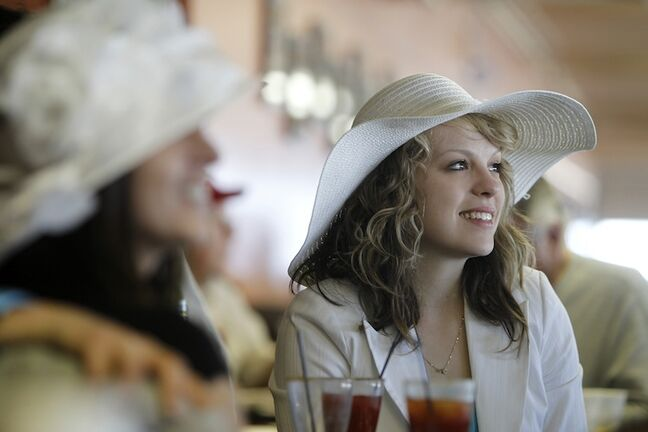 Krista Hodgins watches the 139th Kentucky Derby with friends at Assiniboia Downs Saturday afternoon.