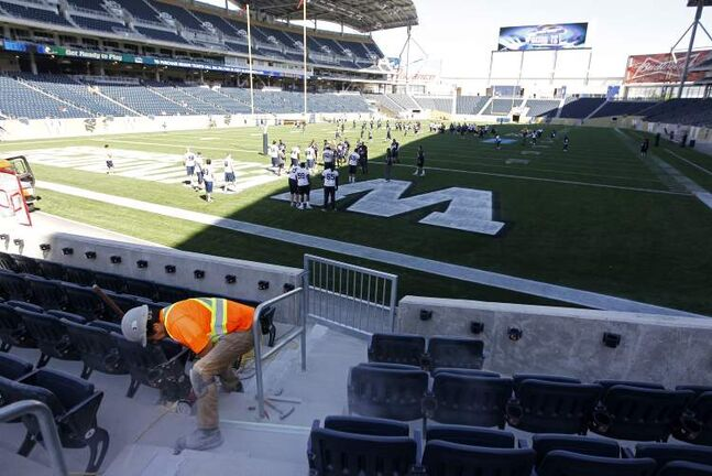 Workers and the Bombers made last-minute preparations at Investors Group Field Tuesday morning for opening night tonight.