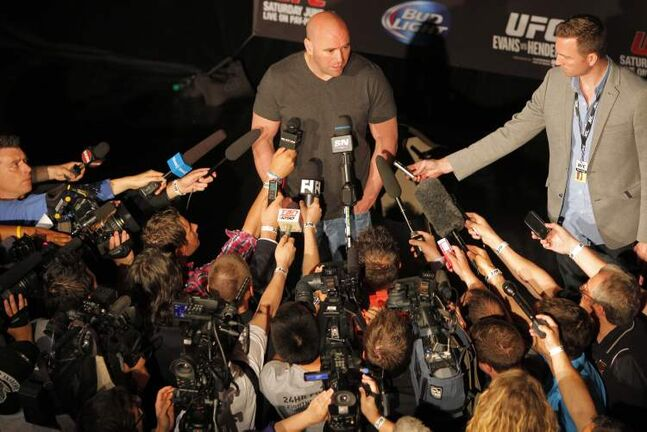 UFC president Dana White drew a large media throng at a press conference in advance of Saturday's UFC 161. On Thursday, White promised to bring the UFC back to Winnipeg.