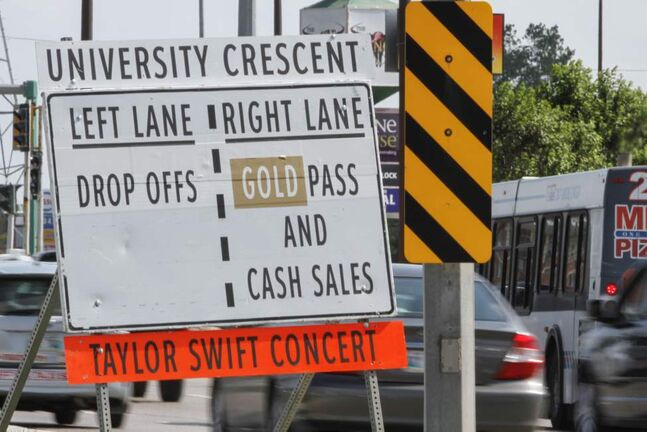 A sign sits at the junction of Pembina Highway and Plaza Drive directing Taylor Swift concert traffic on Saturday.