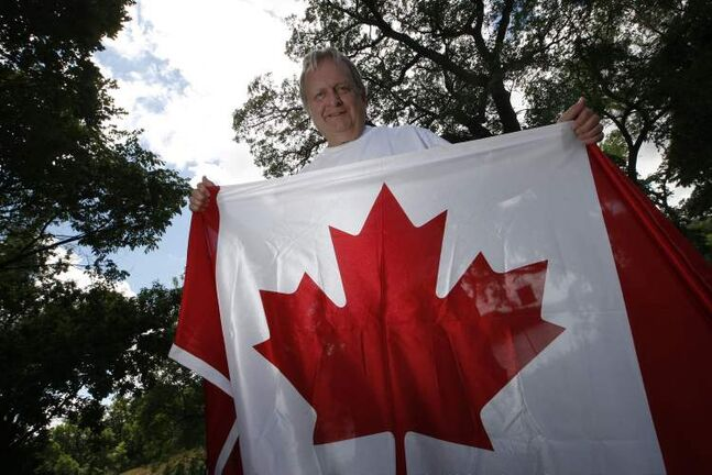 Jim Ingebrigtsen, proud Canadian and flag collector, shows his patriotic colours.