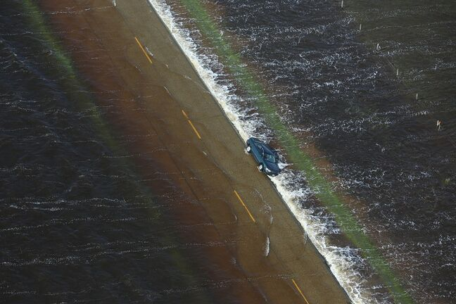 A vehicle is seen washed off of Highway 83 southeast of Reston.