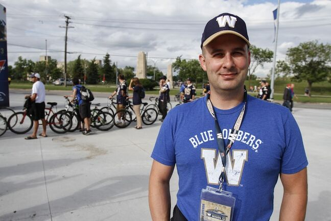 Winnipeggers Terry Crawford biked with son Aiden to Investors Group Field.