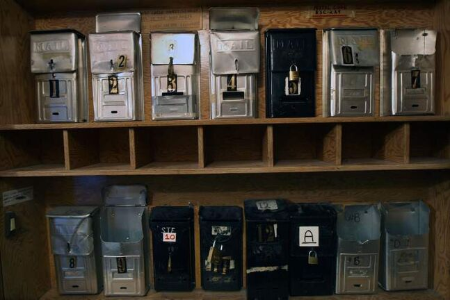 Mailboxes inside a Furby Street rooming house.