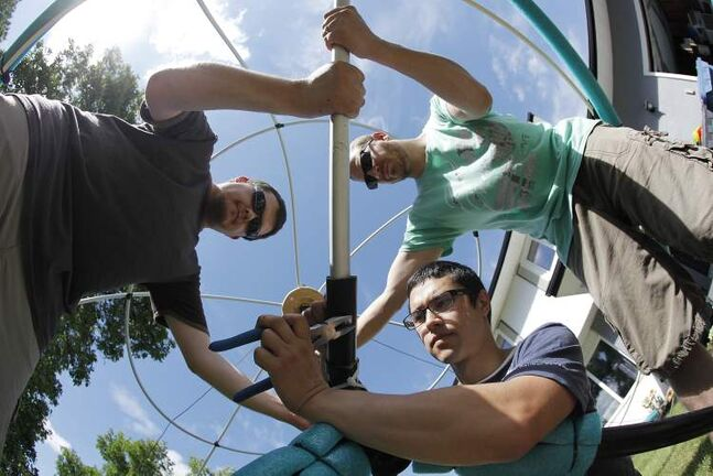 Brent Cross (from left), Jeremy Choy and Kevin Guenther with their Flying Beanie machine. They will compete in the Red Bull Flugtag in Ottawa July 27.