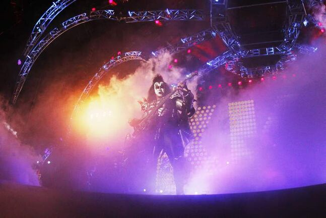 Gene Simmons emerges from the stage effects.