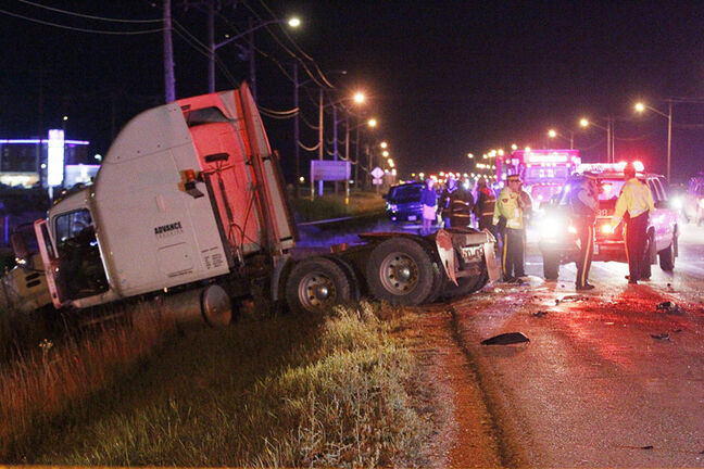 Emergency personnel at the head-on collision on the Trans-Canada Highway.