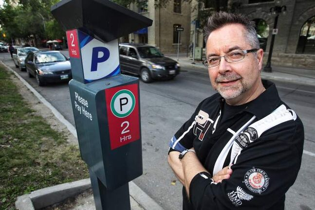 John Giavedoni, president of the Residents of the Exchange District, is upset the city is scrapping the parking-permit program for area residents.