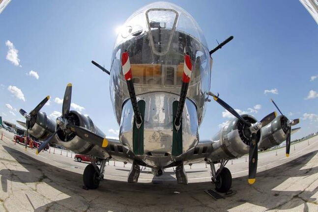Free Press photojournalist Boris Minkevich used a fisheye lens to capture the nose of the B-17 bomber in this photo.