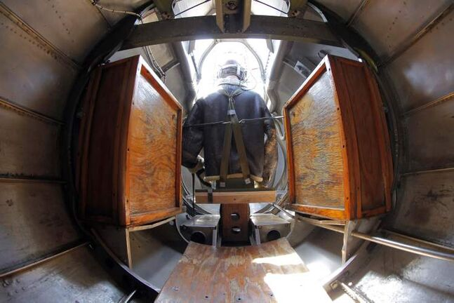 The tail gunner dummy is seen from the inside of the plane.