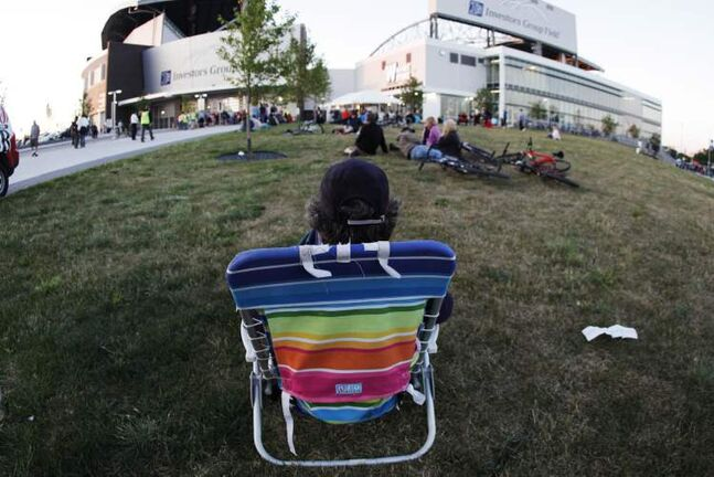 Several hundred people sat outside Investors Group Field and took in the sounds.