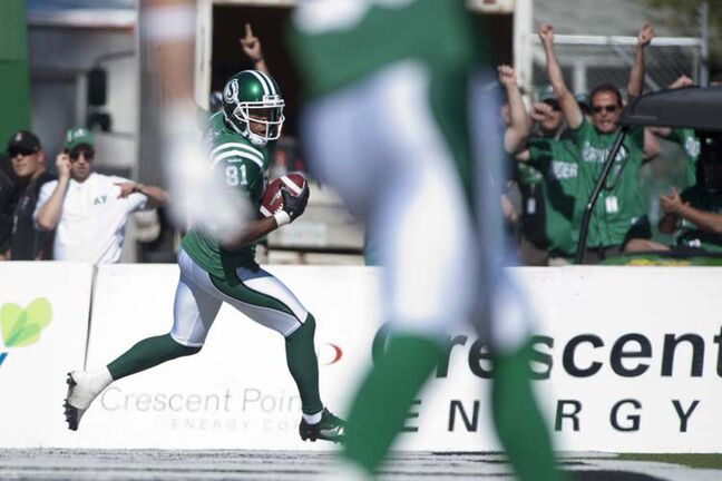 Saskatchewan Roughriders slotback Geroy Simon runs in a touchdown during the first half against the Winnipeg Blue Bombers in CFL football action in Regina, Sask., Sunday, September 1, 2013. THE CANADIAN PRESS/Liam Richards