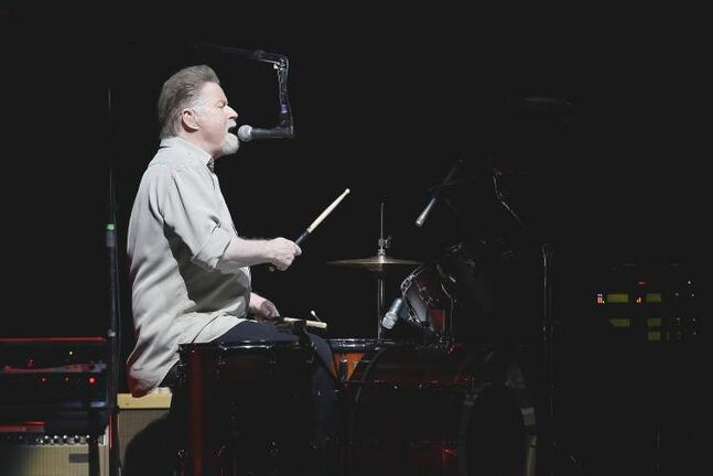 Don Henley handles double duties, singing while playing drums as he has throughout the Eagles' career.