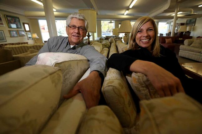 John Wieler, one of the MCC Furniture Thrift Store's founders, and manager Lori Goetz are happy to sell furniture cheap and donate the profit to community-aid programs.