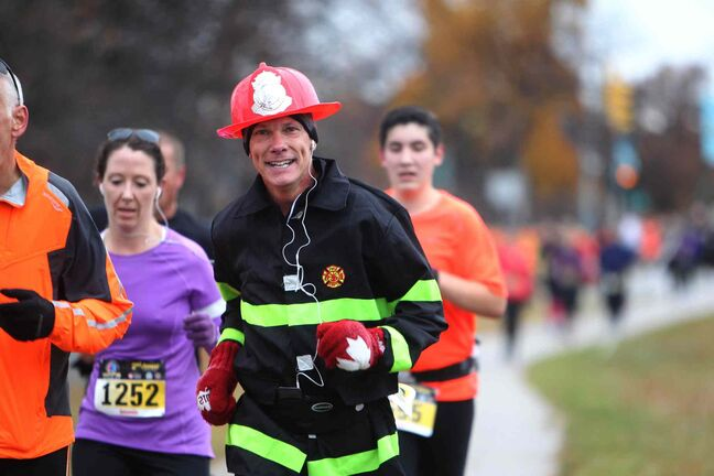 Participants in the second annual Winnipeg Fire and Paramedic Service half marathon don't look concerned about the quickly cooling fall weather Saturday morning.