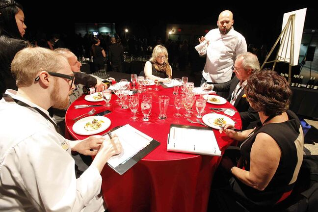 Judges speak to chef Eric Lee of Pizzeria Gusto.