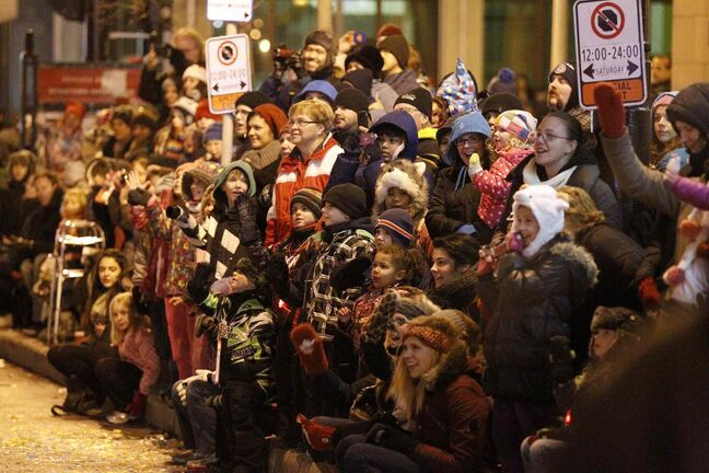 Santa was popular with both children and adults as he and his crew made their way down Portage Ave.