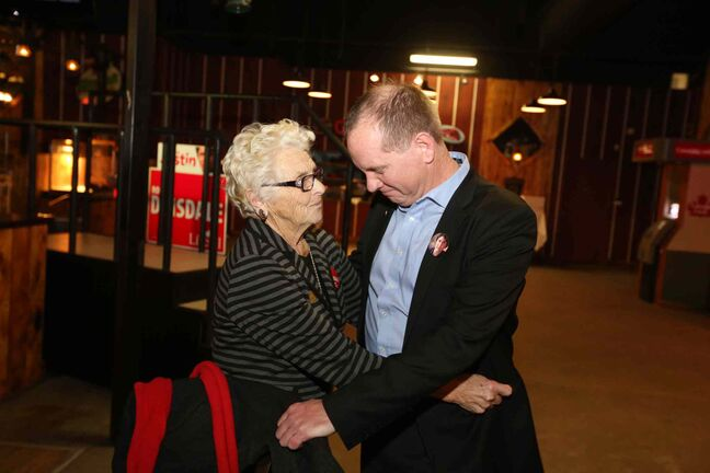 Liberal Party candidate Rolf Dinsdale shares a moment with his mother Lenore after losing the Brandon-Souris byelection to Conservative Party candidate Larry Maguire Monday evening.