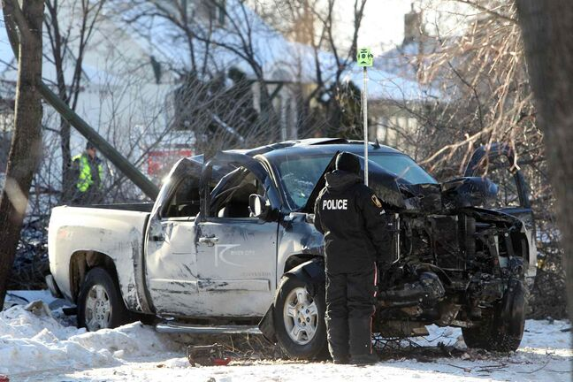 Winnipeg Police Officers survey the scene of a single-vehicle accident on Crystal Avenue that sent one person to the hospital Saturday.