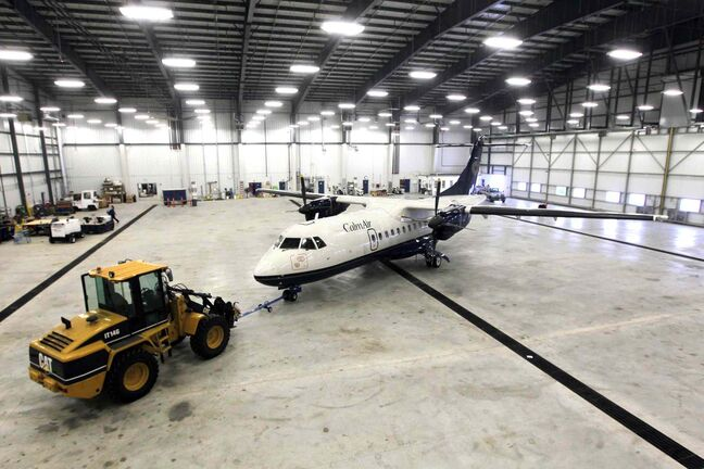 Exchange Income Corp.'s new $10-million, 65,000-square-foot Calm Air hangar is the airport's second-largest. EIC is gearing up for work from across the continent.