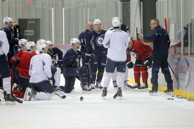 New Head Coach Paul Maurice leads the practice.