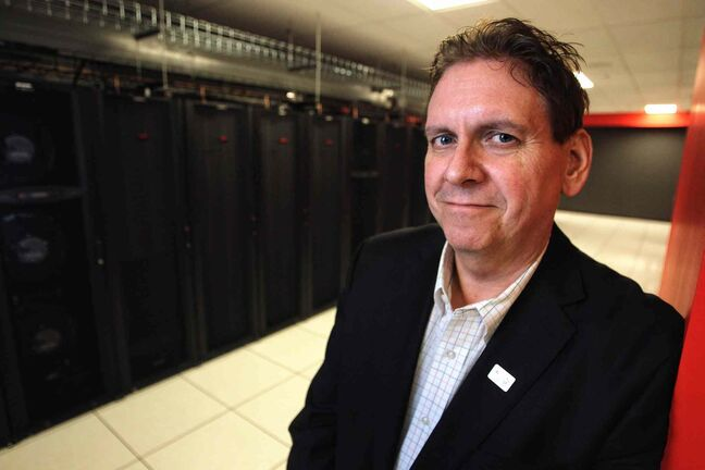 Eugene Roman, Canadian Tire's chief information officer, stands inside one of the computer servers in the new $50-million Data Centre on Portage Avenue at Carlton Street.