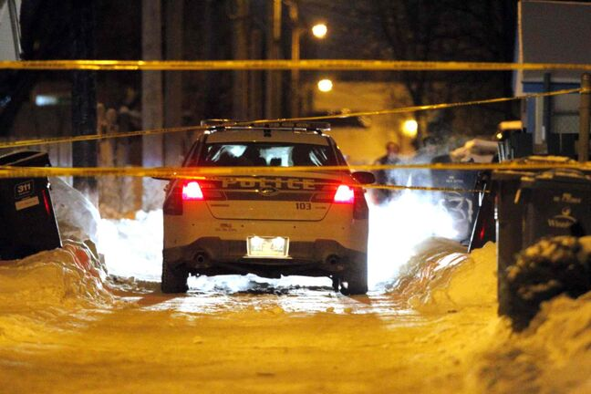 Winnipeg police tape off the scene of a shooting on Magnus Avenue that sent a man to hospital Thursday night.