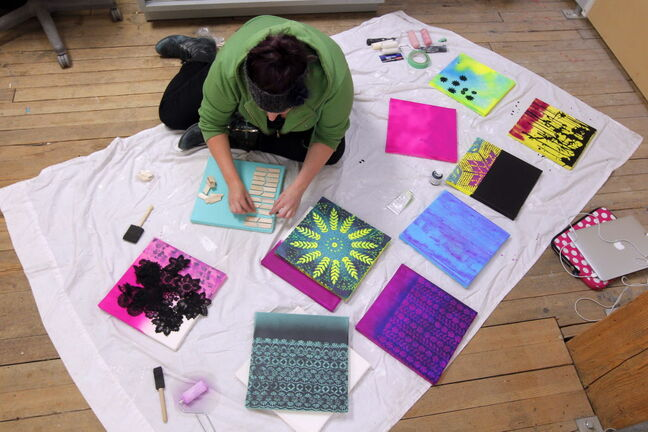 Tara Davis works on several pieces during the 24-hour art-a-thon at Winnipeg's Artbeat Studio. The works will be auctioned off to support the studio.