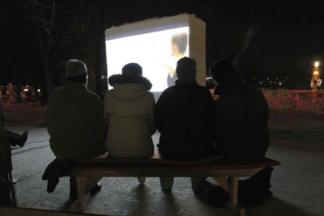Hardy moviegoers catch a flick on the snow screen at The Forks.