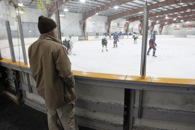 Gary Ostrowski watches his child play hockey at a local rink Tuesday.