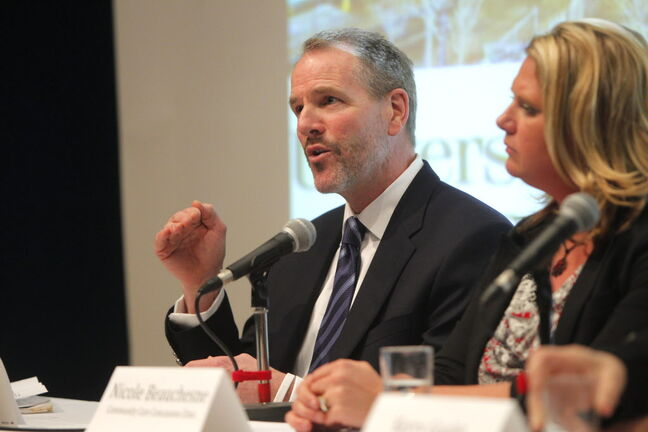 Dr. Neil Craton makes a point at the concussion forum at the University of Winnipeg.