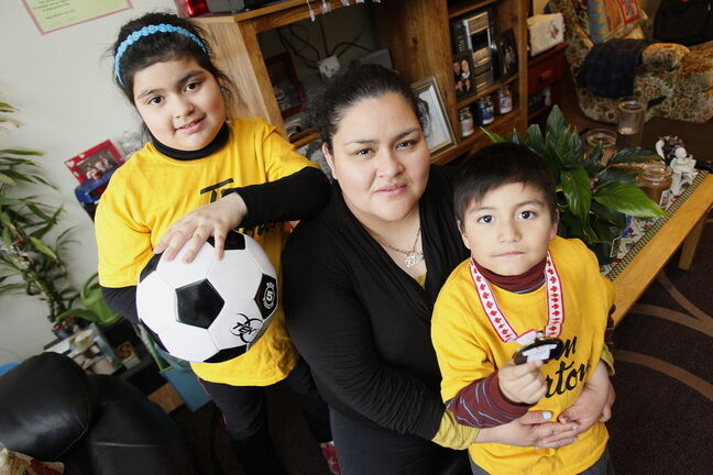 Elsa Garcia with her children, Olivia and Diego, who plan to attend  the Mobile Mini Soccer Program again this year.