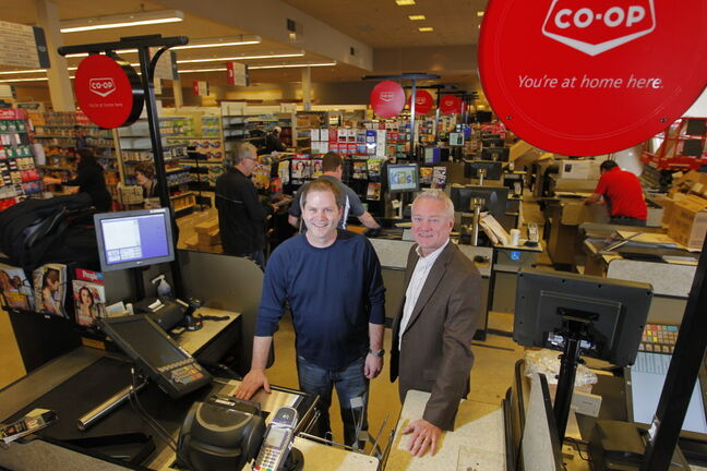Store manager Paul Jackson and Red River Co-op general manager Doug Wiebe spent Wednesday putting the final touches on Co-op's new store in Southdale.