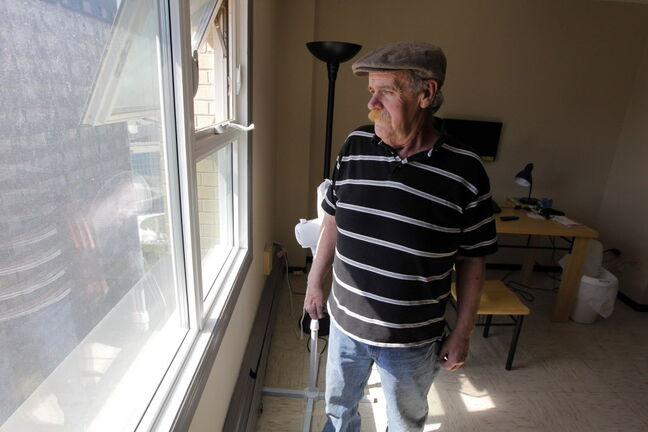 Joseph Berry in his suite on the 20th floor of a downtown Manitoba Housing highrise. Berry lives with numerous health problems, including diabetes and depression.