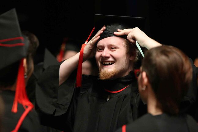 Digital Media Design student Kenton Nickel adjusts his cap before a RRC convocation at the Centennial Concert Hall Wednesday.