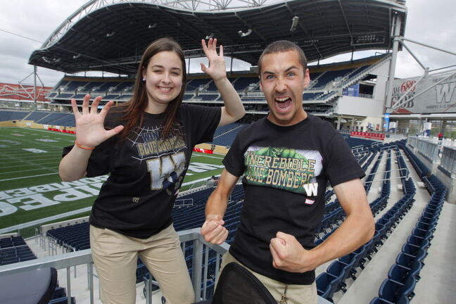 Bomber Store employees Samantha LaPointe and Quinn Smith show off the new Marvel characters T-shirts.