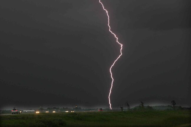 A lightning bolt hits the ground on Hyw 75,  south of Winnipeg Friday night as a thunderstorm approaches the city.