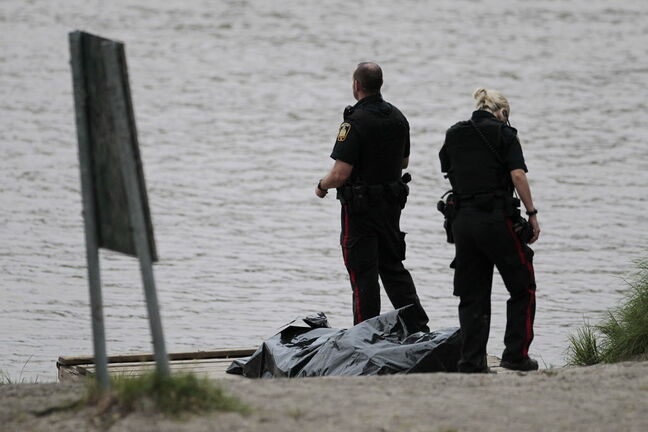 Winnipeg police pulled what appeared to be a body from the Red River on the west bank at Kildonan Park Sunday.