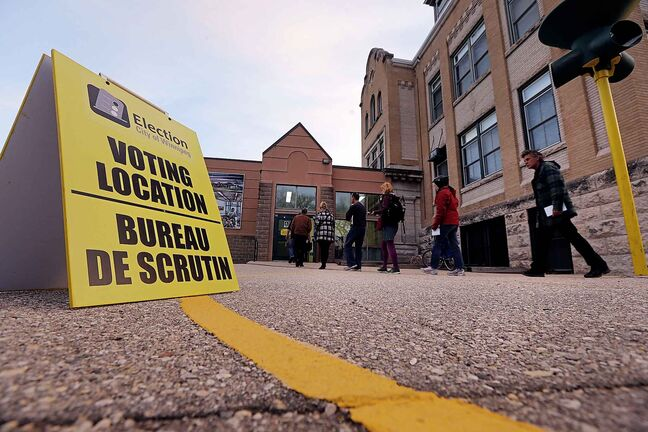Election Day Winnipeg Mayoral Candidates  about a dozen people lined up before 8am at Luxton School polling station to vote . Oct. 22 2014 / KEN GIGLIOTTI / WINNIPEG FREE PRESS