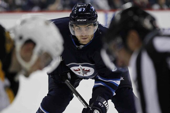 Winnipeg Jets' Michael Frolik waits for the faceoff during the second period.
