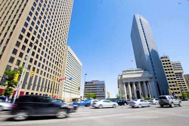 MIKAELA MACKENZIE / WINNIPEG FREE PRESS Portage and Main in Winnipeg on Wednesday, June 6, 2018. City hall expects the first barriers to be taken down to allow pedestrians to cross Portage Avenue East, between the Richardson Plaza and the Bank of Montreal. Mikaela MacKenzie / Winnipeg Free Press 2018.