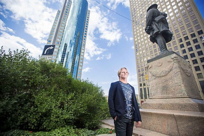 MIKAELA MACKENZIE / WINNIPEG FREE PRESS  Brent Bellamy, architect and active advocate for opening Portage and Main to pedestrians, poses for a portrait at the famed intersection in Winnipeg on Thursday, Sept. 6, 2018.   Winnipeg Free Press 2018.
