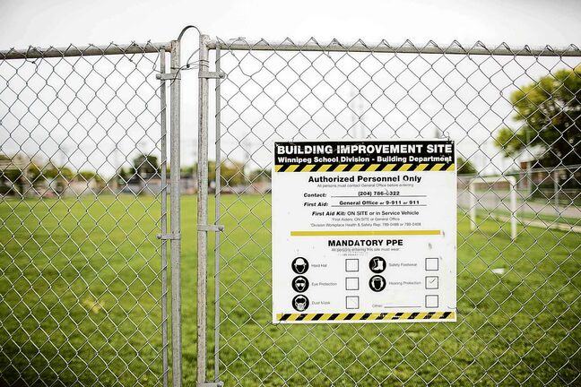 The field is fenced off from the concrete play area after the field was found to have more than 1,000 mg/g lead levels in some parts at Weston School in Winnipeg on Thursday.