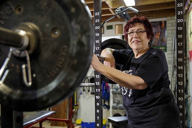 MIKE DEAL / WINNIPEG FREE PRESS</p><p>Susan Haywood a record-breaking 70-year-old power lifter works out in her home gym near Teulon.</p>