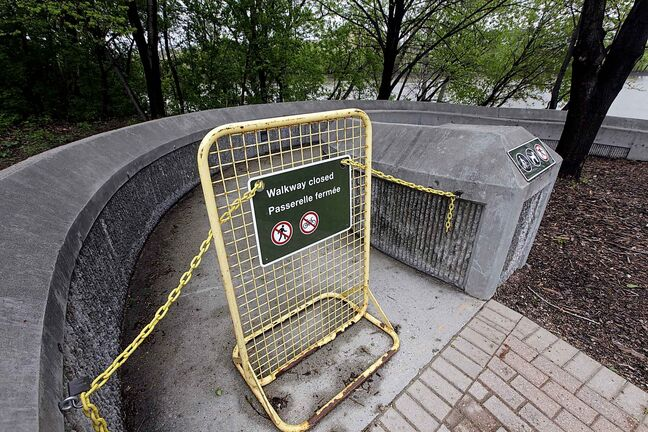 PHIL HOSSACK / WINNIPEG FREE PRESS - The Forks walkway access from the oneida circle is closed. - May 24, 2019.