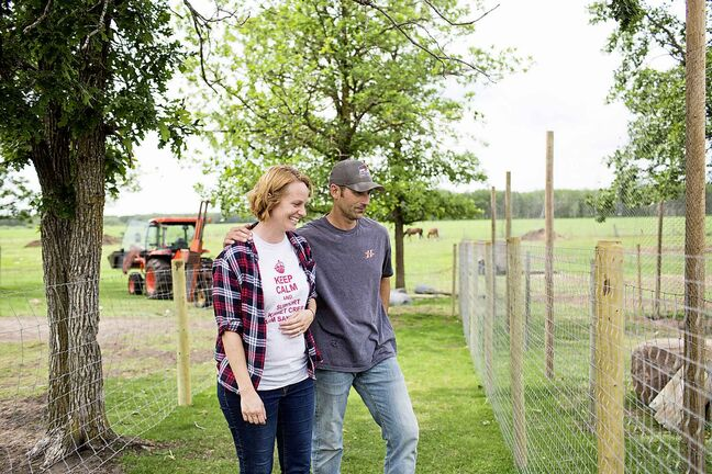 Raelle and Karl Schoenrock, owners of Kismet Creek Farm, by their quarantined turkeys near Steinbach. Their rescue chickens have been infected with ILT (a highly contagious chicken virus) but they've been approved for a long-term quarantine so they don't have to kill them off.