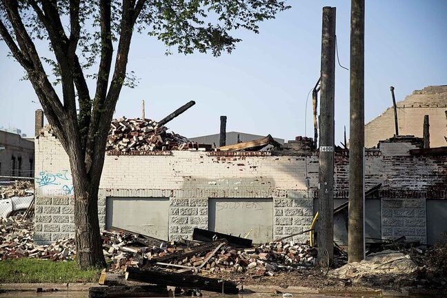 MIKAELA MACKENZIE / WINNIPEG FREE PRESS  The remains of the Jarvis Avenue warehouse are seen a day after the fire.